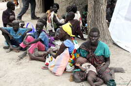 FILE - Residents displaced by fighting between government and rebel forces are seen at a World Food Program (WFP) outpost in Kuernyang Payam, South Sudan May 2, 2015.