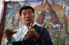 Lobsang Sangay, the incumbent prime minister of the Tibetan government-in-exile, speaks to media after being re-elected for second term in office in Dharmsala, India, Wednesday, April 27, 2016.