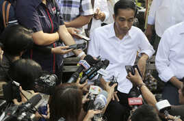 Indonesian President Joko Widodo talks to the media during his visit at a reservoir development project in Jakarta, Indonesia, July 22, 2014.