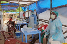 Medical personnel inside a clinic taking care of Ebola patients in the Kenema District on the outskirts of Kenema, Sierra Leone, July 27, 2014.