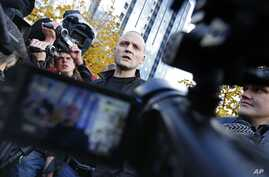 Russian opposition leader Sergei Udaltsov speaks to media after visiting the Russian Investigative Committee's office in Moscow, October 26, 2012.