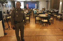 "In this Monday Sept. 10, 2018, photo, a Thai policeman stands inside Foreign Correspondents' Club of Thailand during an event titled: ""Will Myanmar's General Ever Face Justice for International Crimes"" in Bangkok, Thailand."
