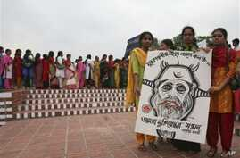 Activists of 'Daughters of Freedom Fighters' stand with a caricature of a war criminal to demand punishment in Saver, on the outskirts of Dhaka, Bangladesh (File Photo)