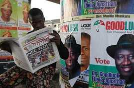 A man reads a local newspaper in Lagos, April 3, 2011