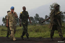 U.N. Deputy Force Commander in Congo, General Adrian Foster, left, of Britain, visits the area where M23 rebels fought with Congo government troops close to the eastern city of Goma, July 29, 2012.