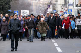 Demonstrators march during a pro Russia rally in Donetsk, Ukraine, Tuesday, March 11, 2014