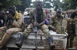 FILE - Seleka fighters take a break in Goya, Central African Republic, June 11, 2014.