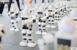 Robots are seen waiting in line for a new iPhone in New Zealand. (Spark)
