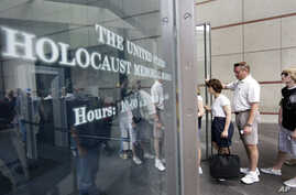 FILE - People line to enter the U.S. Holocaust Memorial Museum in Washington.