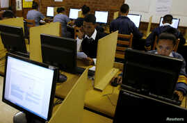 FILE - Students use computers to study at Elswood Secondary School in Cape Town, Nov.  7, 2013.