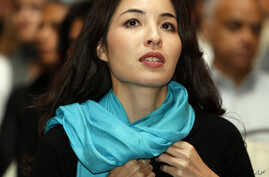 FILE - Roxana Saberi, an Iranian-American arrives to speak on media freedom during a public lecture hosted by the Northwestern University in a Doha, Qatar hotel, Sept. 19, 2010.