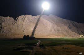 FILE - A missile is fired from city of Kermanshah, in western Iran, targeting the Islamic State group in Syria, June 19, 2017. Syrian government and allied troops have inserted themselves into the battle against IS militants by capturing key areas on