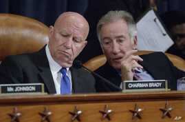 House Ways and Means Committee Chairman Rep. Kevin Brady, R-Texas (left) listens to Rep. Richard Neal, D-Mass., on Capitol Hill in Washington, March 8, 2017, as the committee began markup of the long-awaited plan by Republicans to repeal and replace
