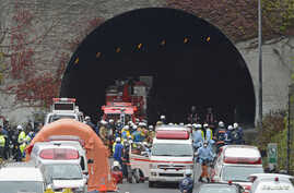 Police officers and firefighters gather in front of the Sasago Tunnel on the Chuo Expressway in Otsuki, Yamanashi prefecture, in this photo taken by Kyodo December 2, 2012.