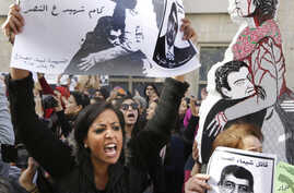 "An Egyptian protester chants anti interior ministry slogans as she holds a poster of Shaimaa el-Sabagh, an activist who was shot dead at a small peaceful protest last Saturday, with Arabic that reads, "" how many martyrs remaining for victory,"" during"