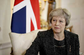 "British Prime Minister Theresa May, seen in this  July 24, 2018 file photo, has told the BBC in an interview scheduled for broadcast Monday, Sept. 17, 2018, that she gets ""irritated"" by the debate over her leadership during Brexit negotiations."
