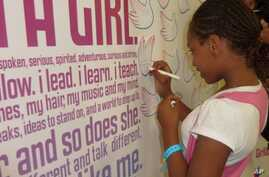 An American girl in Chicago, Illinois signs onto the 'Girl Up' campaign which helps less fortunate girls in other countries.
