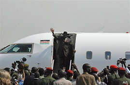 Crowds greet Southern Sudanese president Salva Kiir as he arrives at airport in southern capital Juba from Khartoum, the day after he witnessed the release of results of south's independence referendum for secession from the north, February 8, 2011