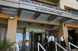 People stand outside the Democratic National Committee (DNC) headquarters in Washington, June 14, 2016.