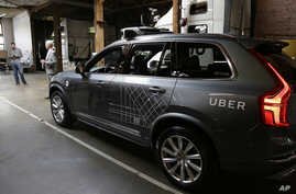 FILE - An Uber driverless car is displayed in a garage in San Francisco, Dec. 13, 2016. Uber announced Dec. 22, 2016, it is moving its self-driving cars to Arizona.