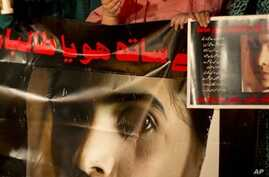 Pakistani protesters pay tribute to 14-year-old schoolgirl Malala Yousufzai, who was shot Tuesday by the Taliban for speaking out in support of education for women, Karachi, Oct. 11, 2012.