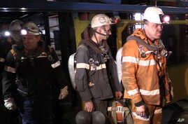 Photo provided by Russian Emergency Situations Ministry press service on Feb. 28, 2016 shows rescuers leaving an elevator in Vorkuta.