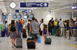 Passengers walk in Nice Cote D'Azur International Airport in Nice, France, one of the host cities for the Euro 16 football championship, June 10, 2016.