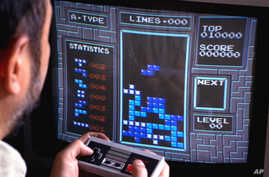 FILE - In this June 1990, photo, Tetris, an addictive brain-teasing video game, is shown as played on the Nintendo Entertainment System in New York.