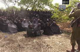 "FILE - This file photo taken from video by Nigeria's Boko Haram terrorist network, Monday, May 12, 2014, shows the missing girls alleged to be abducted April 14, from the northeastern town of Chibok. A Nigerian government official said ""all options a..."