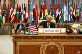 President Donald Trump takes a drink of water before delivering a speech to the Arab Islamic American Summit, at the King Abdulaziz Conference Center, May 21, 2017, in Riyadh, Saudi Arabia.