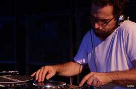DJ Samy Ben Redjeb, who started record label Analog Africa, is seen performing in Utrecht in the Netherlands. (S. Roosblad/VOA)