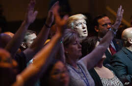 FILE- In this Oct. 30, 2016, file photo, Republican presidential candidate Donald Trump stands during a service at the International Church of Las Vegas in Las Vegas. President Trump's pledge to scrap limits on church political activity could have sw