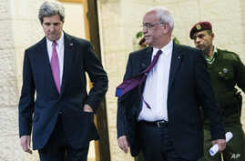 FILE - U.S. Secretary of State John Kerry, center, and Palestinian negotiator Saeb Erekat, right, leave the presidential compound after meeting with Palestinian President Mahmoud Abbas in the West Bank city of Ramallah on Saturday, Jan. 4, 2014.