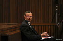 Olympic and Paralympic track star Oscar Pistorius sits in the dock during his trial for the murder of his girlfriend Reeva Steenkamp, at the North Gauteng High Court in Pretoria, March 25, 2014.