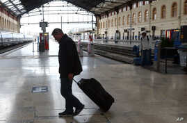 Passenger walks past an empty a platform at the Saint-Charles railway station, in Marseille , southern France, June, 1, 2016.