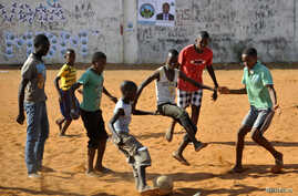 Children play soccer in Maputo, Mozambique, Nov.16, 2013.