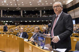 EU Commission President Jean Claude Juncker, left, addresses Members of European Parliament on Brexit during a plenary session at the European Parliament in Brussels on Jan. 30, 2019.