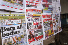 A close up of newspaper front pages focusing on the Ebola outbreak, including a newspaper, left,  reading 'Burn all bodies' in the city of Monrovia, Liberia, Thursday, July 31, 2014. The worst recorded Ebola outbreak in history surpassed 700 deaths i