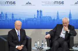FILE - International Atomic Energy Agency (IAEA) Director General Yukiya Amano (L) and Iran's Foreign Minister Mohammad Javad Zarif attend the annual Munich Security Conference in Germany, Feb. 2, 2014.