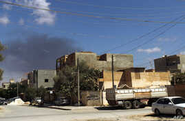 Smoke rises following an air strike in Libya's eastern coastal city of Benghazi, Sept. 1, 2014.