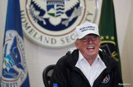 U.S. President Donald Trump speaks during a roundtable discussion with officials after arriving for a visit to the U.S.-Mexico border at McAllen-Miller International Airport in McAllen, Texas, Jan. 10, 2019.