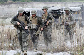 FILE - U.S. troops are seen on patrol during joint U.S.-Philippines military exercises in Tarlac province, north of Manila.