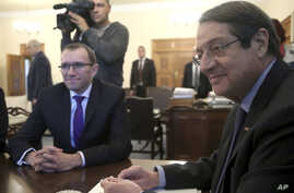 U.N. Special Advisor of the Secretary-General Espen Barth Eide, left, and Cyprus' President Nicos Anastasiades sit during their meeting at the presidential palace in divided capital Nicosia, Cyprus, Nov. 28, 2016.
