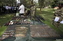 Kenya wildlife officials display firearms recovered from elephant poachers at their headquarters, Nairobi, June 22, 2012.