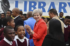 British Prime Minister Theresa May meets pupils during a visit at the the ID Mkhize High School in Gugulethu, Cape Town, South Africa, Aug. 28, 2018.