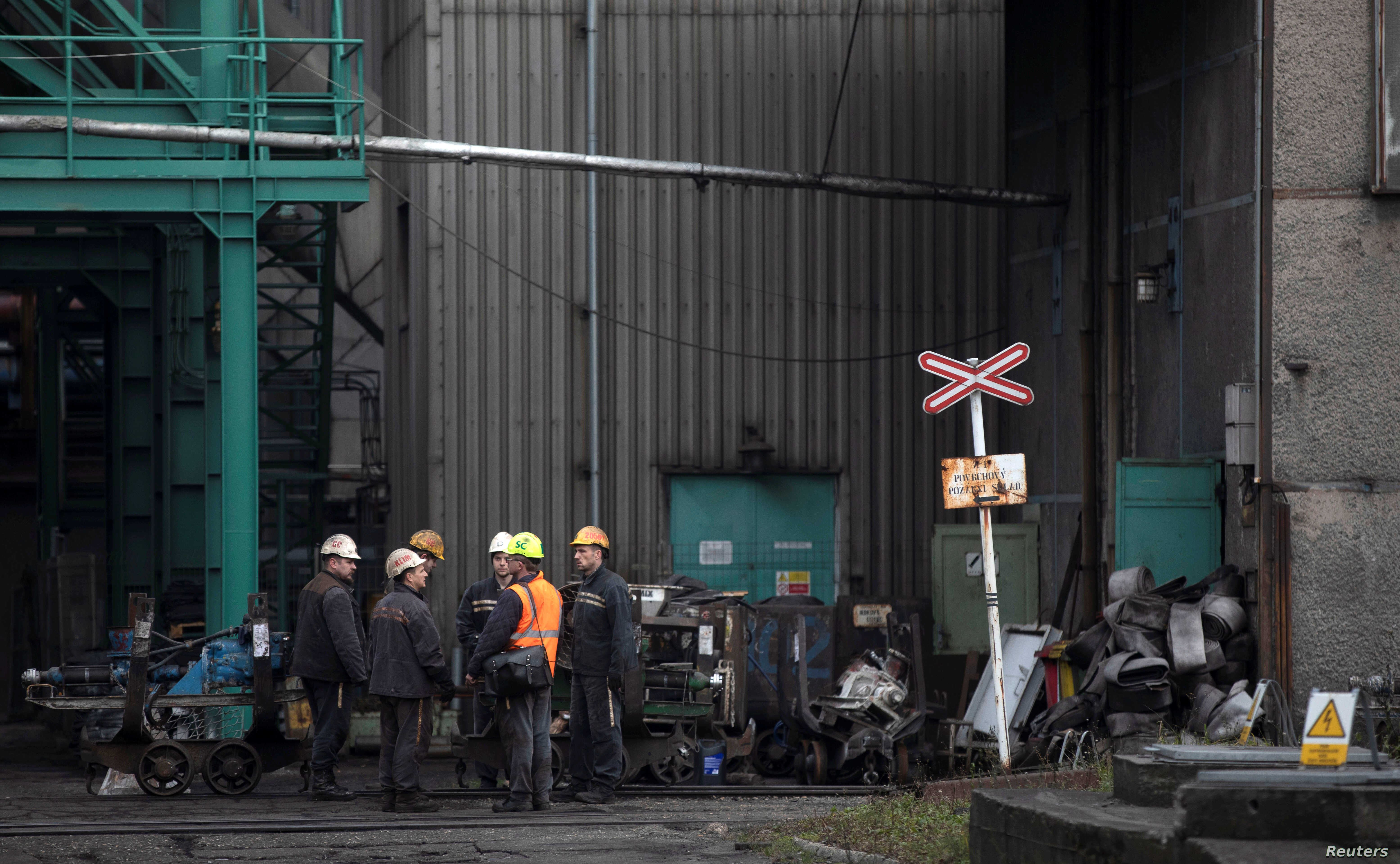 Miners stand at a compound of the CSM hard coal mine after a methane explosion near the town of Karvina, Czech Republic, December 21, 2018.