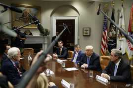 """President Donald Trump speaks during a roundtable on the """"Foreign Investment Risk Review Modernization Act"""" in the Roosevelt Room of the White House, Aug. 23, 2018, in Washington."""