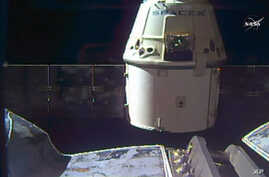 In this frame grab taken from NASA Television, a SpaceX Dragon capsule separates from a robotic arm of the International Space Station en route back to Earth with a load of science experiments and gear from the space station, Aug. 26, 2016.