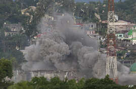 Debris flies as Philippine Air Force fighter jets bomb suspected locations of Muslim militants as fighting continues in Marawi city, southern Philippines, June 9, 2017.