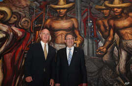 California Governor Jerry Brown, left, and U.S. Ambassador to Mexico Anthony Wayne, pose for photos next to a mural by Mexican painter David Alfaro Siqueiros before a press conference at the Soumaya museum in Mexico City, July 28, 2014.